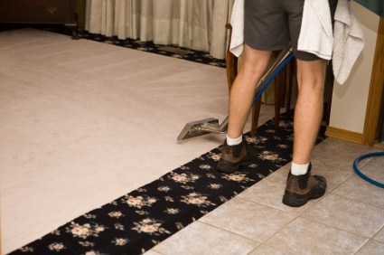 1st Choice Cleaning technician cleaning carpet via hot water extraction in Montclair CA.